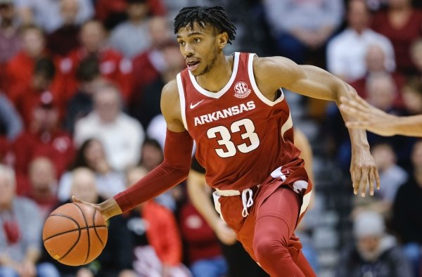 Jimmy Whitt Jr. drives handles the basketball during the Razorbacks' 71-64 victory over Indiana on Dec. 29, 2019.