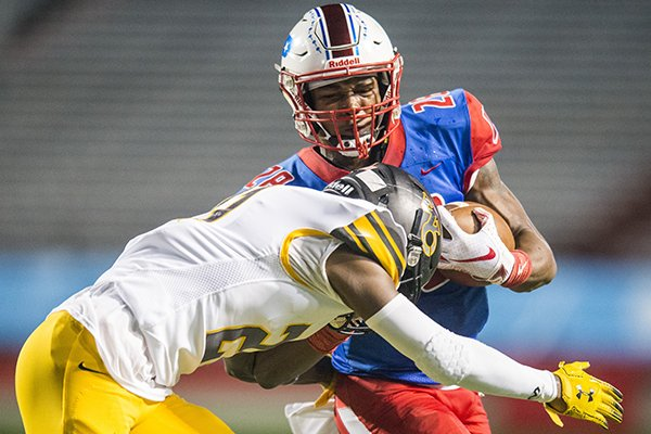 Little Rock Parkview's Trent Bennett (28) is hit by Watson Chapel's Kobe Evans (21) during a game Thursday, Oct. 10, 2019, at War Memorial Stadium in Little Rock.