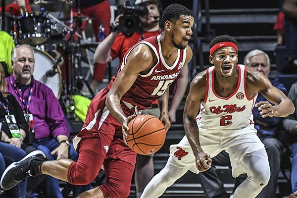 Arkansas guard Mason Jones (15) is defended by Ole Miss guard Devontae Shuler (2) during an NCAA college basketball game Saturday, Jan. 11, 2020, in Oxford, Miss. (Bruce Newman/The Oxford Eagle via AP)