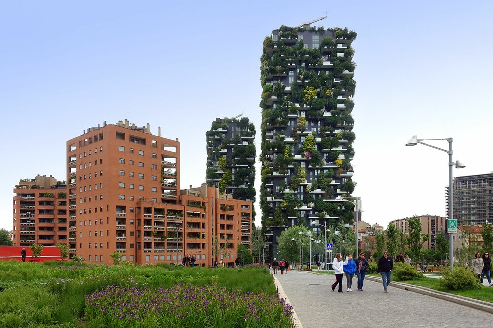 Milan's redeveloped Porta Nuova neighborhood shows visitors a modern side of the city, including two tree-covered skyscrapers. (Rick Steves' Europe/Rick Steves)