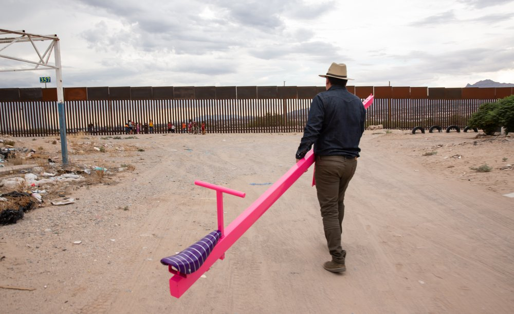 Architectural studio Rael San Fratello installed three pink seesaws between the metal slats of the United States-Mexico border wall so children on both sides can play together. (Special to the Democrat-Gazette)