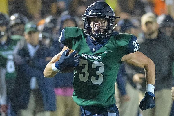 Little Rock Christian tight end Jackson Woodard (33) runs with the ball during a game against Wynne on Friday, Nov. 22, 2019, at Warrior Field in Little Rock.