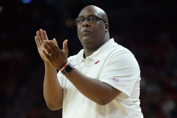 Arkansas assistant coach Corey Williams directs his players Friday, Nov. 22, 2019, during the second half of play against South Dakota in Bud Walton Arena in Fayetteville.