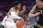 Arkansas guard Jimmy Whitt Jr. (left) looks to drive Wednesday, Jan. 15, 2020, as he is pressured by Vanderbilt forward Dylan Disu (1) during the first half in Bud Walton Arena.