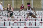 G'Auna Edwards of Arkansas (right) and Leah Molter of Oklahoma Baptist run in the women's 100-meter hurdles Friday, April 12, 2019, at John McDonnell Field in Fayetteville.