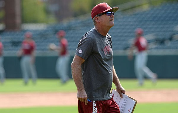 Arkansas coach Dave Van Horn directs his players Friday, Sept. 6, 2019, during practice at Baum-Walker Stadium in Fayetteville.