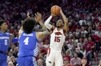 Arkansas guard Mason Jones (15) pulls up to shoot over Kentucky defenders Nick Richards (4) and Ashton Hagans (0) during the first half of an NCAA college basketball game, Saturday, Jan. 18, 2020, in Fayetteville. (AP Photo/Michael Woods)