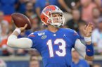 Florida quarterback Feleipe Franks (13) throws a pass during the first half of an NCAA college football game against Miami Saturday, Aug. 24, 2019, in Orlando, Fla. (AP Photo/Phelan M. Ebenhack)
