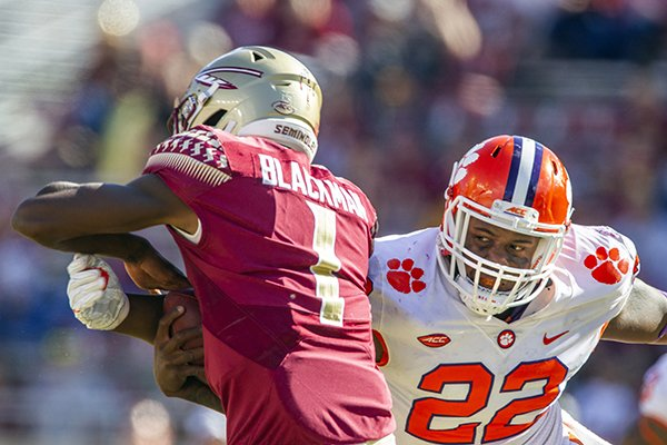 Clemson defensive lineman Xavier Kelly, right, sacks Florida State back up quarterback James Blackman in the second half of an NCAA college football game in Tallahassee, Fla., Saturday, Oct.27, 2018. (AP Photo/Mark Wallheiser)