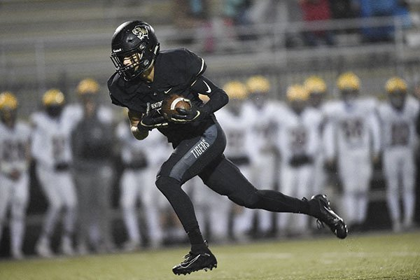 Bentonville receiver Chas Nimrod scores a touchdown during a game against Little Rock Catholic on Friday, Nov. 22, 2019, at Tiger Stadium in Bentonville.