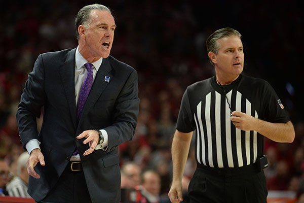 TCU coach Jamie Dixon directs his players Saturday, Jan. 25, 2020, during the first half of play against Arkansas in Bud Walton Arena.