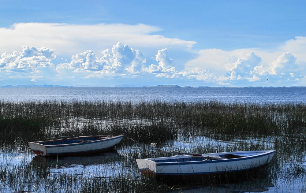The residents of Luquina Chico anchor their row boats near the shore of their village, which looks out upon the vast expanse of Lake Titicaca. By mid-afternoon, distance thunderheads create fantastic cloudscapes in the sky. (TNS/Thomas Curwen)