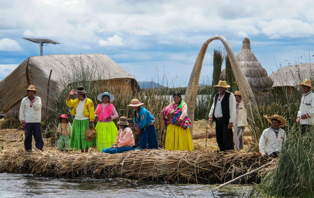 Grateful for visitors, Antonio Jullahui and the other residents of a floating island on Lake Titicaca gather to wave goodbye to their departing guests. The Uros economy is largely depended upon tourism. (TNS/Thomas Curwen)