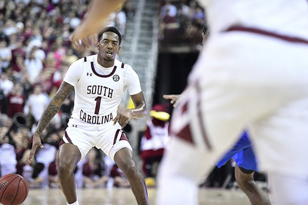 South Carolina guard T.J. Moss (1) dribbles the ball against Kentucky during the second half an NCAA college basketball game Wednesday, Jan. 15, 2020, in Columbia, S.C. South Carolina defeated Kentucky 81-78. (AP Photo/Sean Rayford)