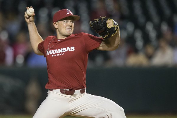 Kevin Kopps, Arkansas pitcher, delivers to a Oklahoma batter in the first inning Friday, Sept. 20, 2019, during an exhibition game. Kopps if vying for the third starting pitcher spot in the Arkansas rotation.