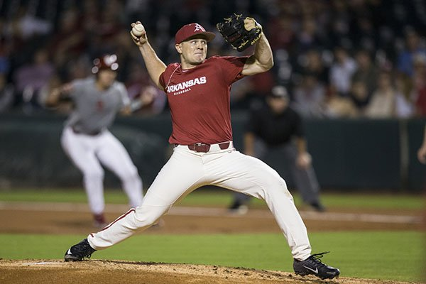 Arkansas pitcher Kevin Kopps throws during a scrimmage against Oklahoma on Friday, Sept. 20, 2019, in Fayetteville.