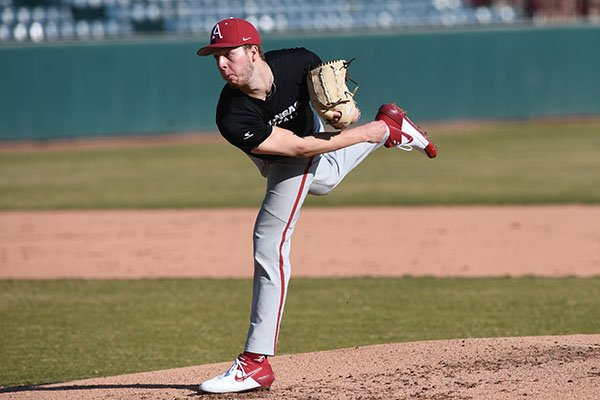 Arkansas pitcher Caleb Bolden throws during a scrimmage Monday, Jan. 27, 2020, at Baum-Walker Stadium in Fayetteville.