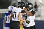 Little Rock Central right end Davis Hawkins (11) celebrates with tackle Makilan Thomas (72) after scoring during a game against Rogers on Friday, Sept. 13, 2019, in Rogers.