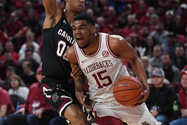 Arkansas' Mason Jones (15) drives to the basket during a game against South Carolina on Wednesday, Jan. 29, 2020, in Fayetteville.