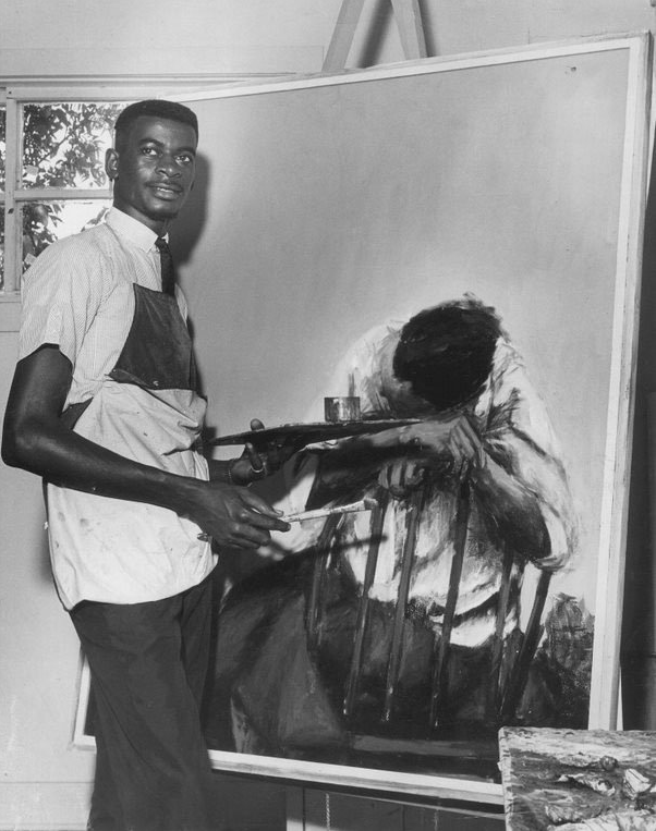 """Henri Linton with his painting """"Alone,"""" circa 1965. Linton won the Award for Best Portrait or Figure in Oil in the 1968 Atlanta University 27th Annual Exhibition of Paintings, Sculptures and Prints by Negro Artists.  (Courtesy Henri Linton)"""