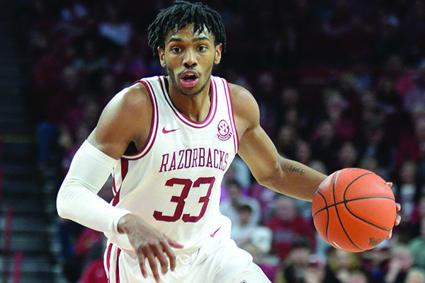 Arkansas guard Jimmy Whitt (33) looks to drive to the lane Saturday, Jan. 25, 2020, during a game against TCU in Bud Walton Arena.