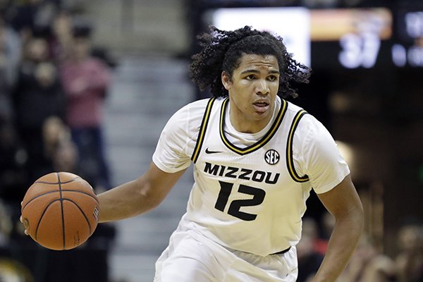 Missouri's Dru Smith brings the ball down the court during the second half of an NCAA college basketball game against Georgia Tuesday, Jan. 28, 2020, in Columbia, Mo. Missouri won 72-69. (AP Photo/Jeff Roberson)