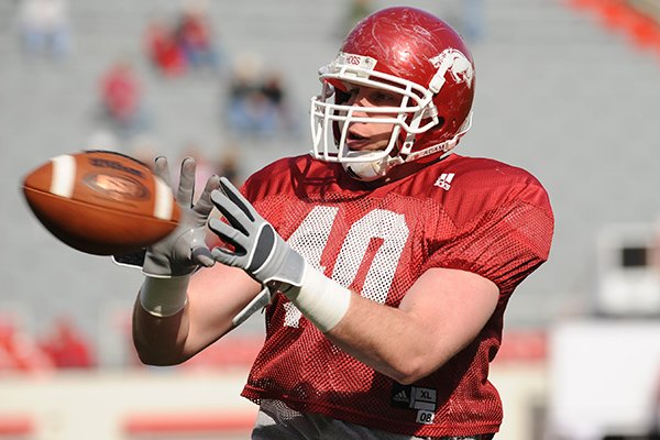 Arkansas tight end Joseph Henry catches a pass during practice Saturday, April 4, 2009, in Fayetteville.