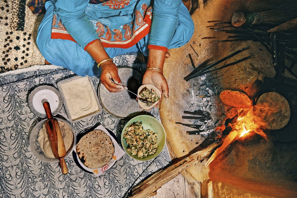 A woman makes stuffed roti at the Kalasan Nursery Farm near the town of Karsog in Himachal Pradesh, India. In Himachal Pradesh, the northern Indian state straddling the Western Himalayas, Punjabi and Tibetan flavors meet. (The New York Times/Poras Chaudhary)