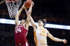 Tennessee forward John Fulkerson (10) blocks a shot by Arkansas forward Ethan Henderson (24) during an NCAA college basketball game, Tuesday, Feb. 11, 2020 in Knoxville, Tenn. (Brianna Paciorka/Knoxville News Sentinel via AP)