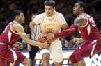 Tennessee guard Santiago Vescovi (25) moves through Arkansas guard Jalen Harris (5) and Arkansas forward Reggie Chaney (35) during an NCAA college basketball game, Tuesday, Feb. 11, 2020 in Knoxville, Tenn. (Brianna Paciorka/Knoxville News Sentinel via AP)