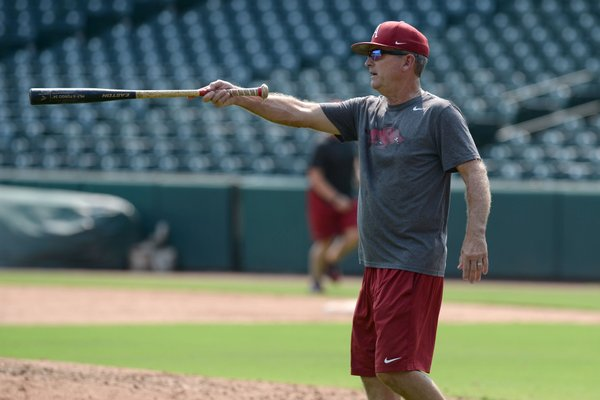 Arkansas coach Dave Van Horn hits ground balls Friday, Sept. 6, 2019, during practice at Baum-Walker Stadium in Fayetteville. Arkansas will open the 2020 season at home Friday against Eastern Illinois.