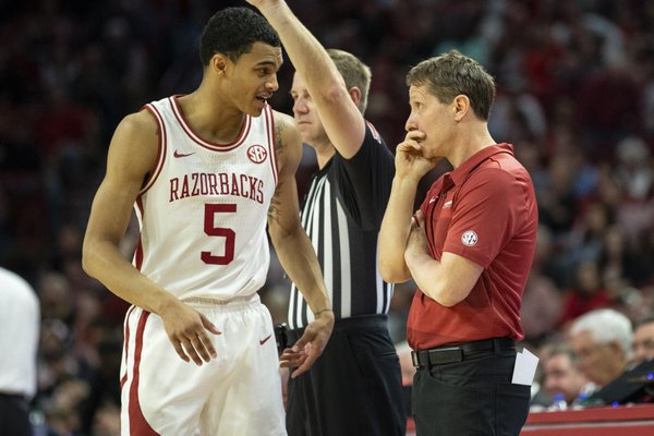 Arkansas Junior Jalen Harris (5) talking to coach Eric Musselman during at time out against Mississippi State, at Bud Walton Arena, Fayetteville, on February 15,2020