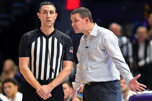 LSU head coach Will Wade, right, complains to referee Todd Austin concerning a call late in the second half of an NCAA college basketball game, Tuesday, Feb. 11, 2020, in Baton Rouge, La. LSU won 82-78. (AP Photo/Bill Feig)