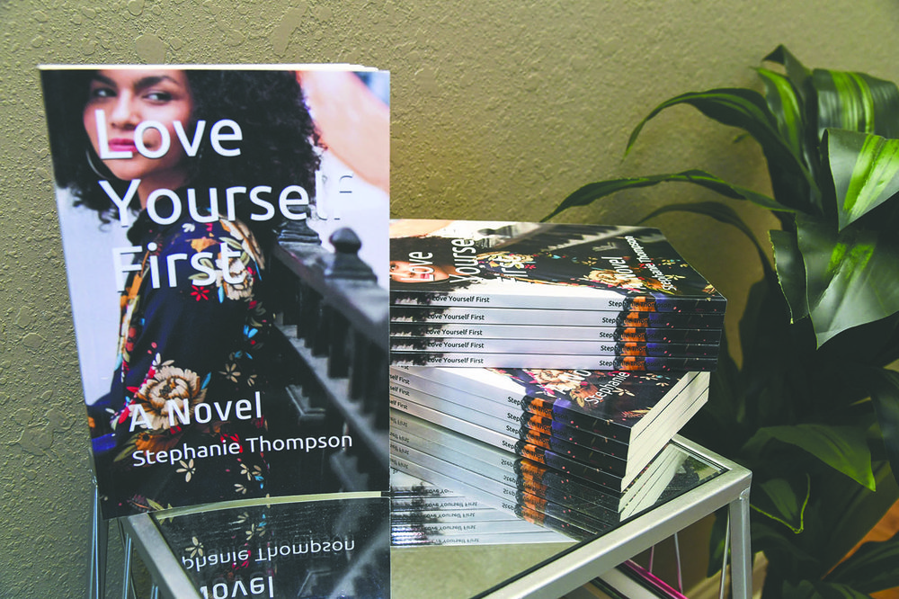 "Author Stephanie Thompson's second book ""Love Yourself First"" in her home office on Jan. 9, 2020. - Photo by Grace Brown of The Sentinel-Record"