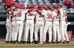 Arkansas baseball players huddle prior to a game against Eastern Illinois on Sunday, Feb. 16, 2020, in Fayetteville.