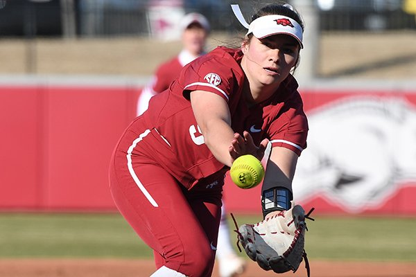 Arkansas pitcher Autumn Storms fields during a game against Boston on Thursday, Feb. 20, 2020, in Fayetteville.