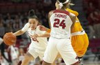 Arkansas guard Amber Ramirez drives around a Tennessee defender while teammate Taylah Thomas (24) sets a screen during a game Thursday, Feb. 20, 2020, in Fayetteville.