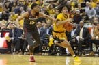 Missouri's Dru Smith, right, dribbles past Arkansas' Mason Jones, left, during the second half of an NCAA college basketball game Saturday, Feb. 8, 2020, in Columbia, Mo. Missouri beat Arkansas 83-79 in overtime. (AP Photo/L.G. Patterson)