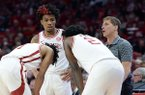 Arkansas guard Desi Sills (left facing) and coach Eric Musselman (right facing) are shown during a game against Missouri on Saturday, Feb. 22, 2020, in Fayetteville.
