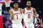 Arkansas guards Isaiah Joe (1) and Jeantal Cylla celebrate a 3-point basket Saturday, Feb. 22, 2020, during the first half of play against Missouri in Bud Walton Arena in Fayetteville.