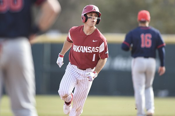 Arkansas second baseman Robert Moore runs the bases after hitting a home run during a game against Gonzaga on Saturday, Feb. 22, 2020, in Fayetteville.