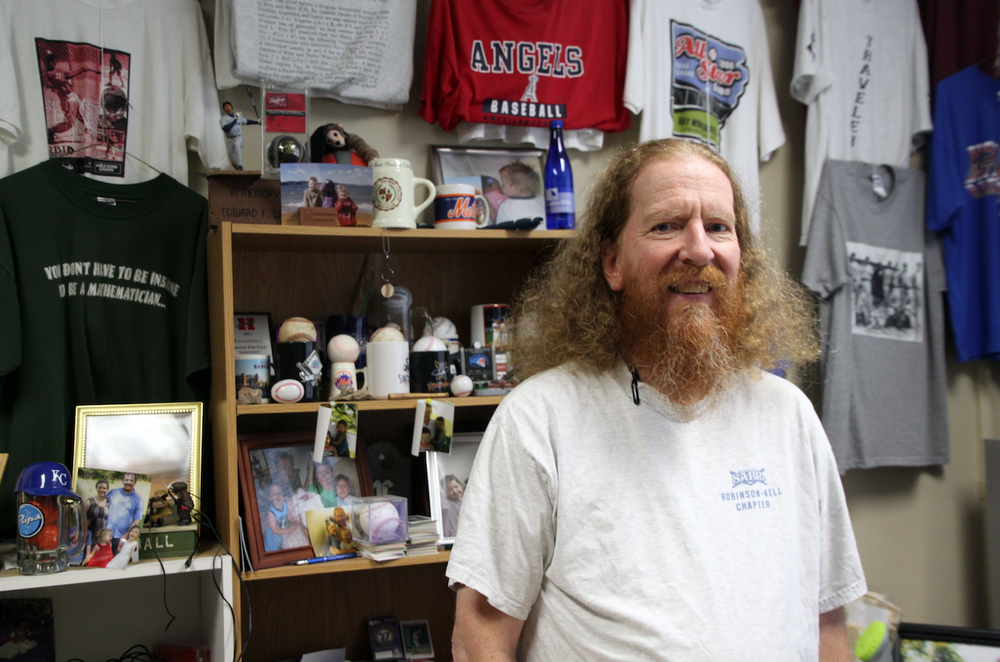 Baseball fan Fred Worth, mathematics professor at Henderson State University, has an office packed with his archive of baseball memorabilia. Worth wrote a textbook that draws upon his academic career and his passion for baseball, College Mathematics Through Baseball.