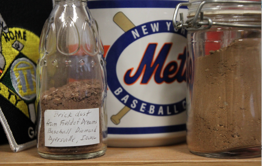 A jar on the shelf in Fred Worth's office contains dirt from the Field of Dreams baseball diamond in Dyersville, Iowa, where the movie Field of Dreams was filmed.