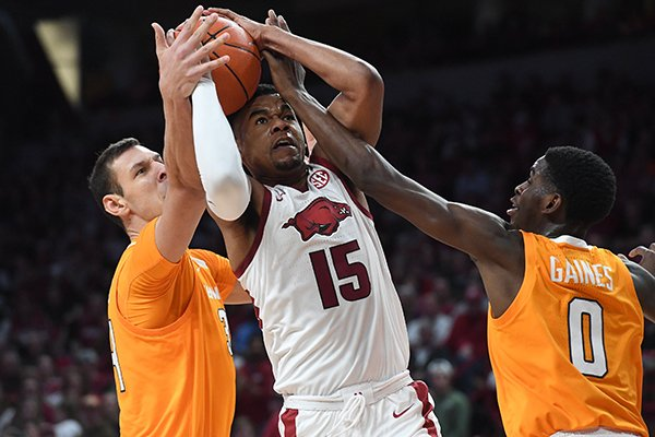 Arkansas' Mason Jones goes up for a shot as Tennessee's Davonte Gaines (0) and Uros Plavsic defend during a game Wednesday, Feb. 26, 2020, in Fayetteville.