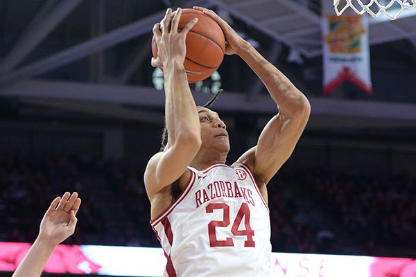 Arkansas forward Ethan Henderson (24) takes a shot in the lane Saturday, Feb. 22, 2020, over Missouri players during the second half in Bud Walton Arena in Fayetteville.