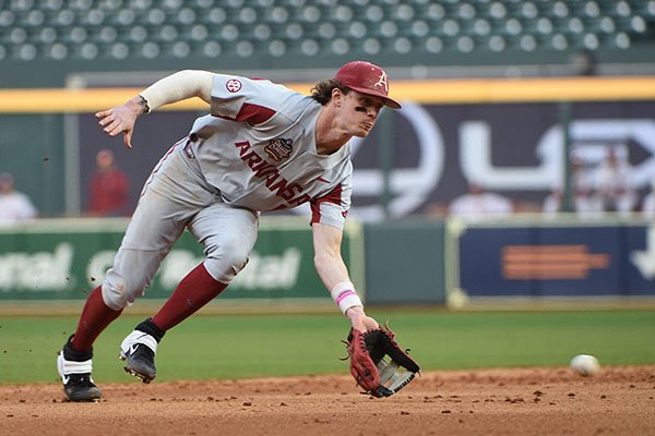 Arkansas shortstop Casey Martin fields a ball during a game against Oklahoma on Friday, Feb. 28, 2020, during the Shriners Hospitals for Children College Classic at Minute Maid Park in Houston.