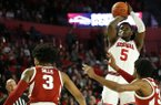 Georgia's Anthony Edwards (5) shoots over Arkansas guard Jimmy Whitt Jr., right, and Arkansas guard Desi Sills (3) during an NCAA college basketball game in Athens, Ga., Saturday, Feb. 29, 2020. (Joshua L. Jones/Athens Banner-Herald via AP)