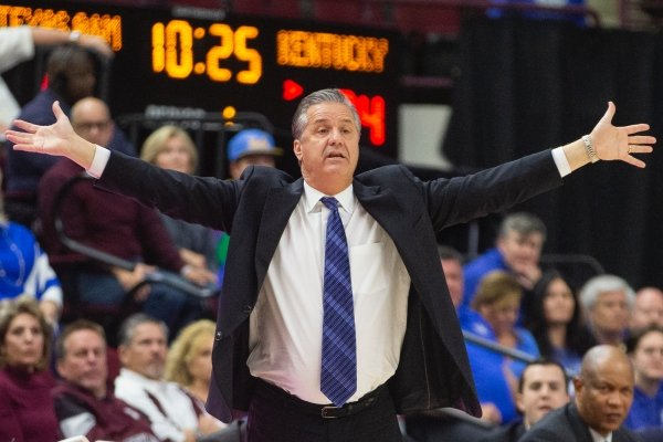 Kentucky head coach John Calipari gestures during a game against Texas A&M during the first half of an NCAA college basketball game Tuesday, Feb. 25, 2020, in College Station, Texas. (AP Photo/Sam Craft)