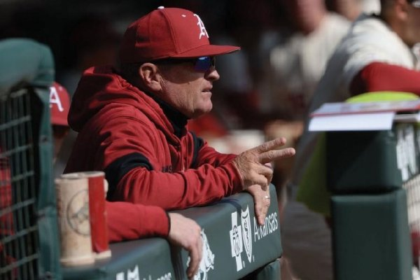 Arkansas coach Dave Van Horn watches from the dugout Thursday, Feb. 20, 2020, during the Hogs' 7-5 win over Gonzaga at Baum-Walker Stadium.