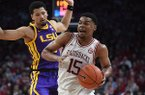 Arkansas' Mason Jones (15) drives past LSU's Skylar Mays during a game Wednesday, March 4, 2020, in Fayetteville.